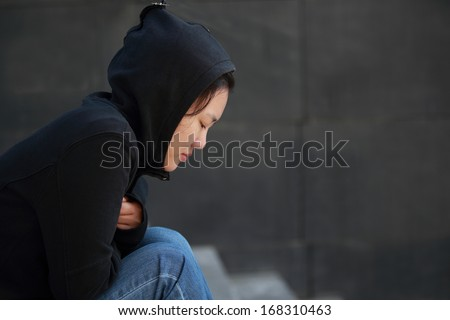 Lonely woman sitting on the stairs  - stock photo