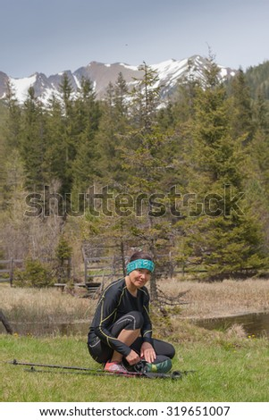 Lonely woman tourist while hiking in the Alps - stock photo