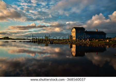 Lonely Wooden House on the Sea Shore, Calm Sunrise Landscape Shot in 4K Ultra HD - stock photo