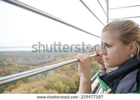 Lonely young woman on viewing tower, Berlin, Germany - stock photo