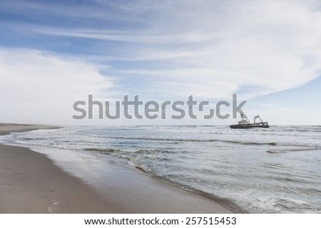 lonesome beach with ship wreck, skeleton coast park, Namibia, Africa - stock photo