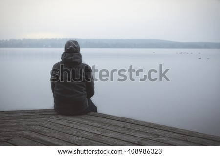 Lonesome Guy At The Lake - stock photo