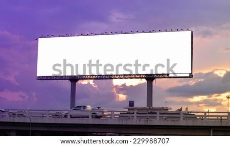long advertisement billboard at twilight - stock photo