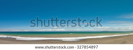Long and empty ocean coast beach panoramic view background  - stock photo