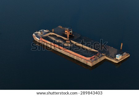 long arm excavator working on river barge in Wroclaw Poland - stock photo