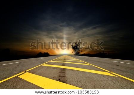 Long asphalt with the Sunset dark blue sky. - stock photo