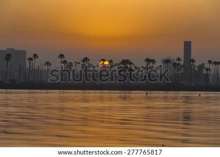 Long Beach, CA - Apr 19, 2015:  Sun rises on the Long Beach Grand Prix for the Tequila Patron Sports Car Racing Showcase at in Long Beach, CA. - stock photo