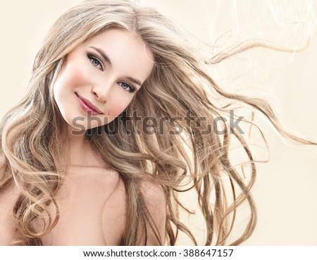 Long blond Hair.  Beauty Model Girl with Luxurious Hair. - stock photo