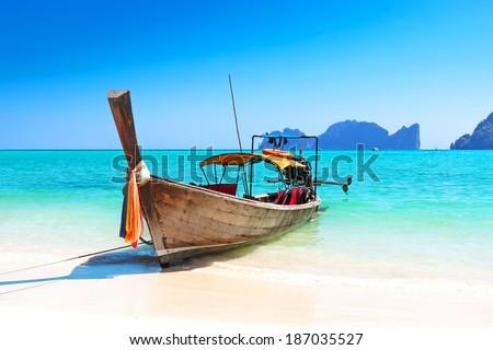 Long boat and tropical beach, Andaman Sea, Thailand - stock photo
