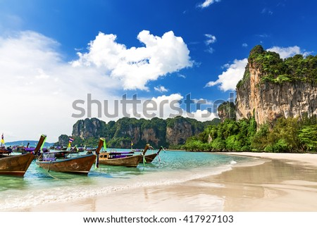 Long boats and Railay beach in Krabi Thailand - stock photo