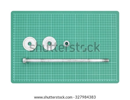 Long bolt and nut with blank space on green pad isolate - stock photo