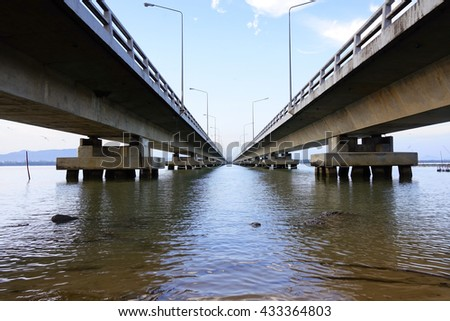 Long concrete bridge for main road cross lake in the morning:selective focus with shallow depth of field. - stock photo