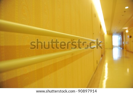 long corridor in  hospital with hand rail. - stock photo