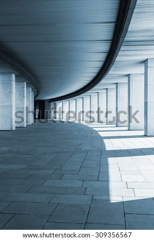 long corridor of a building with columns. toned image  - stock photo