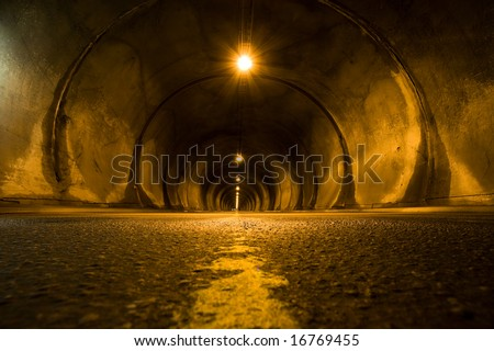 long dark tunnel front perspective view - stock photo