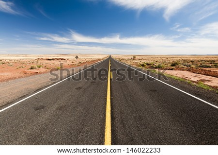Long desert highway - stock photo