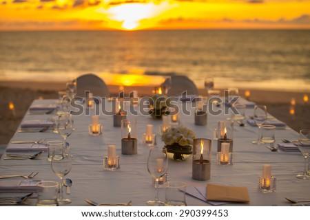 long dinner table on the beach at Thailand - stock photo