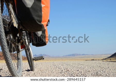 Long distance cycling in the Namib, Namibia - stock photo