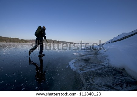 Long distance ice skating, Sweden. - stock photo