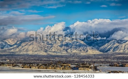 Long distance view of Salt Lake City Utah looking North East after a winter snow storm/ Across Salt Lake Valley - stock photo