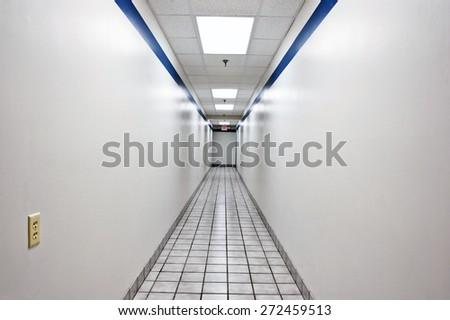 Long Empty Hallway Or Corridor In Office Building - stock photo