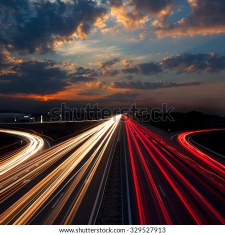 Long Exposure abstract urban background - Speed Traffic at Sundown Time - light trails on motorway highway at night, fantastic sky - stock photo