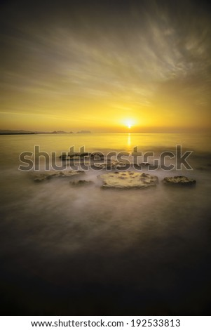 long exposure at sunrise in the coast of Almeria, Spain - stock photo