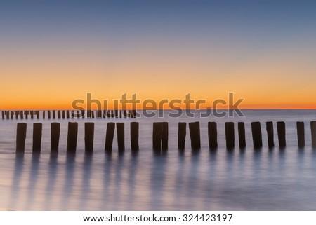 Long exposure breakwater photo. Baltic sea shore.  - stock photo