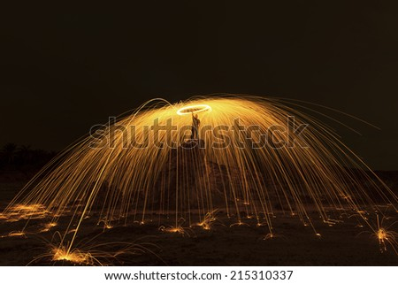 Long exposure burning and spinning of steel wool - stock photo