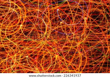 Long Exposure Curved Lines from Light Garland - stock photo