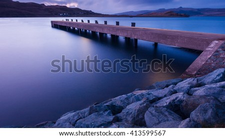 Long exposure image of a scottish pier at sunset - stock photo