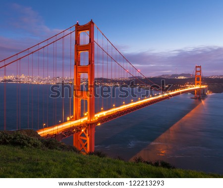 Long exposure image of Golden Gate Bridge at sunset. - stock photo