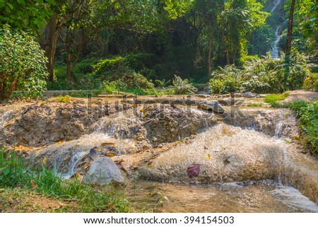 long exposure image of waterfall and rock on day time for background usage.(tharn tong waterfall ,wnagnuar district, Nakhon Lampang Province Thailand) - stock photo