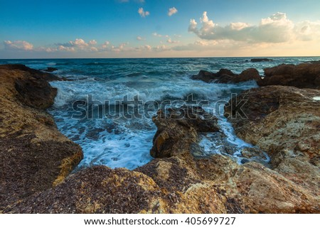 Long exposure landscape with sunrise and blue sea - stock photo