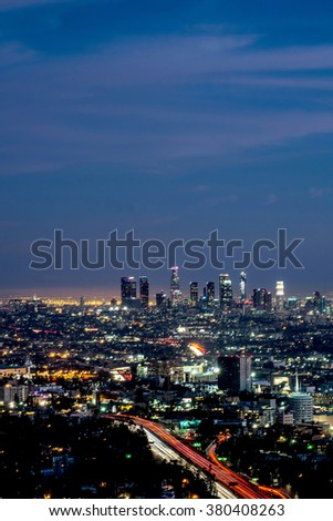 Long exposure night view of Los Angeles downtown and surrounding metropolitan area at dusk - stock photo