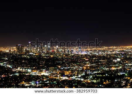 Long exposure night view of Los Angeles downtown and surrounding metropolitan area from the Hollywood hills - stock photo