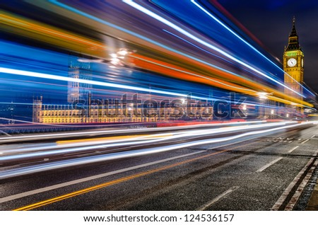 Long exposure of a bus in front of the Big Ben in London, UK - stock photo