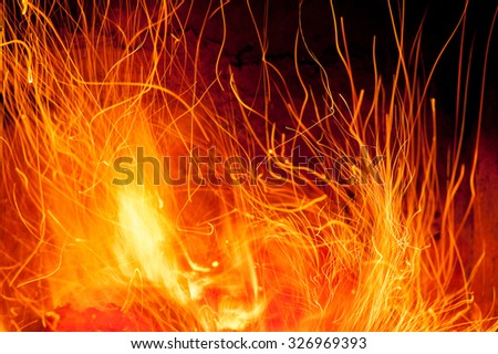 Long exposure of fire and sparks - stock photo