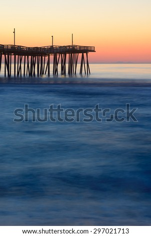 Long Exposure of Fishing Pier at Sunrise - stock photo