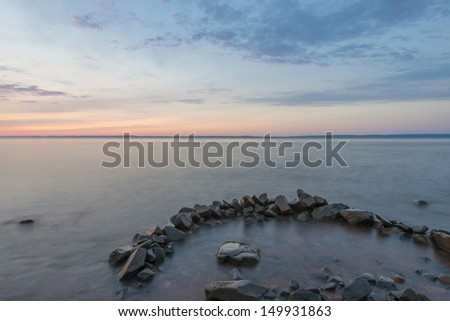 Long exposure of misty ocean and rocks (Blomidon Estate Winery, Nova Scotia, Canada) - stock photo