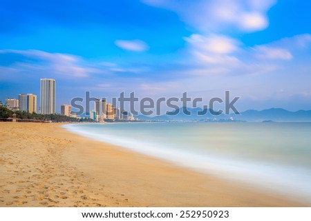 Long exposure of Nha Trang City Beach, Vietnam. Early Morning - stock photo