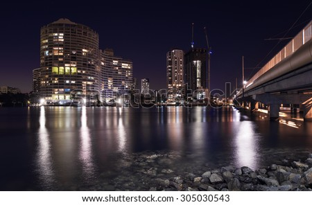 Long Exposure of the Southport City Skyline with Sundale Bridge and a Wide Open Canal at Twilight, Gold Coast, Queensland, Australia - stock photo