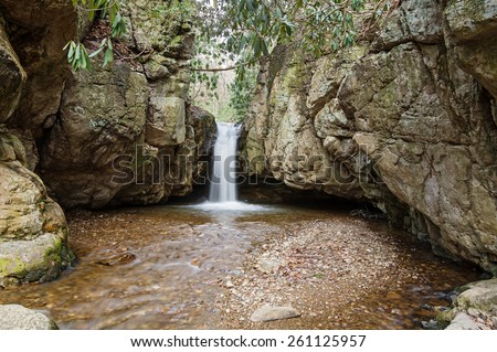 long exposure of waterfall in Stoney Creek at Blue Hole in Tennessee with silky water - stock photo