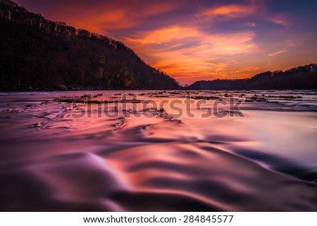 Long exposure on the Shenandoah River at sunset, from Harper's Ferry, West Virginia. - stock photo