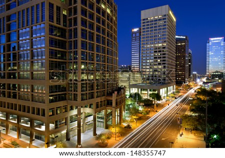 Long exposure photo of the a city street in downtown Phoenix, Arizona at night. - stock photo