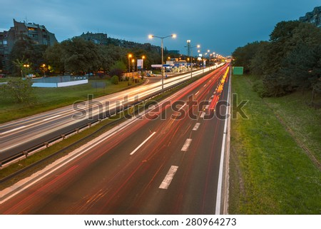 Long exposure photo on a freeway with light trails at dusk in Belgrade - Serbia - stock photo