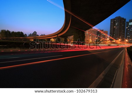 Long exposure photo to urban focus of a major ring highway viaduct polishing trace night Scene - stock photo