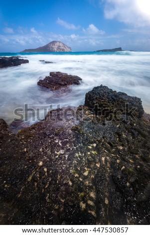 Long exposure seascape on Hawaii beach - stock photo