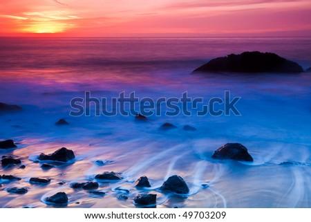 Long Exposure Sunset Photo at Marshall Beach in San Francisco, California. - stock photo