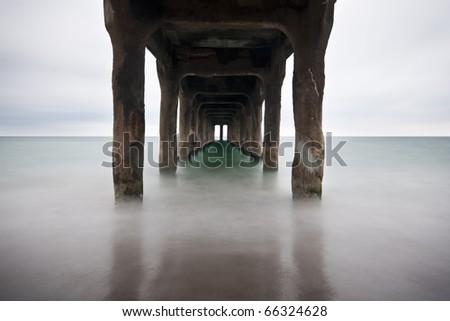 Long Exposure Under the Manhattan Beach Pier - stock photo